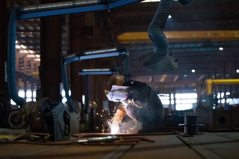 Employee works at a steel processing production line at a factory in Hefei