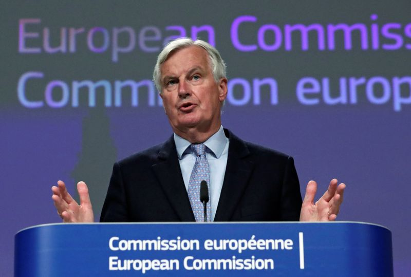 FILE PHOTO: EU's Brexit negotiator Michel Barnier gives a news conference after Brexit negotiations, in Brussels