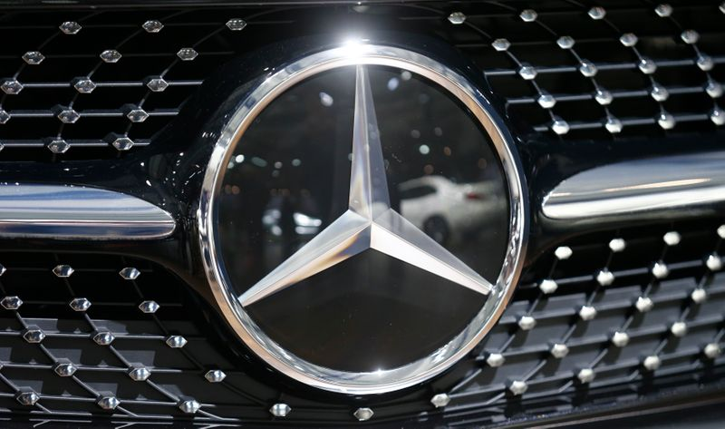 The logo of Mercedes-Benz is pictured on a car prior to the Daimler annual shareholder meeting in Berlin