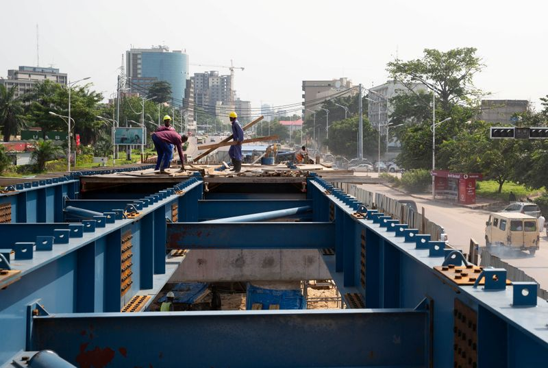 Congolese workers are seen at a construction site for a new overpass dubbed