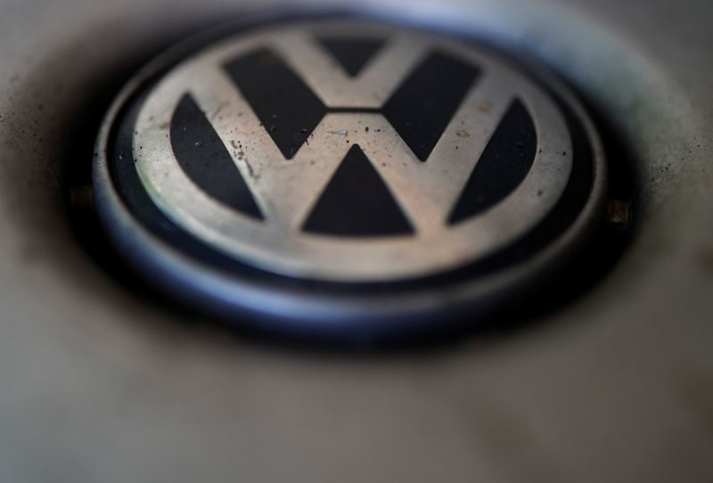 A logo of German carmaker Volkswagen is seen on a car parked on a street in Paris