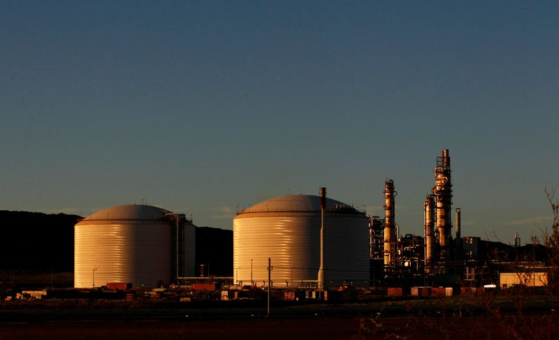 FILE PHOTO: The Woodside gas plant is seen at sunset in Burrup at the Pilbarra region in Western Australia