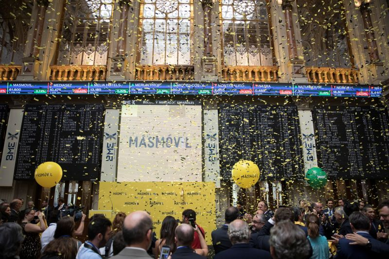 People attend the Masmovil bourse debut in Madrid