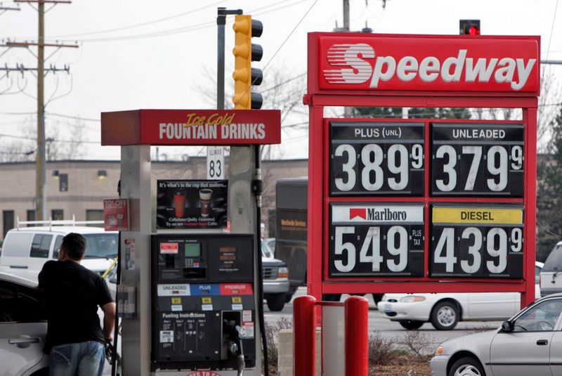 FILE PHOTO: A motorist fuels-up his car at a Speedway gas station in Des Plaines, Illinois