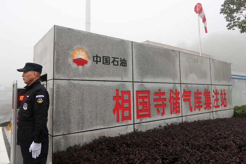 Security guard stands at the entrance of Xiangguosi underground gas storage run by PetroChina in Chongqing