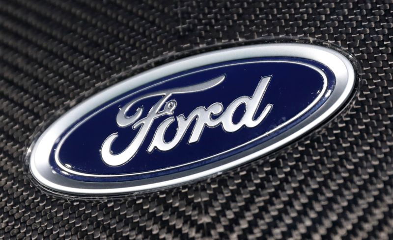 FILE PHOTO: The Ford logo is seen on a vehicle at the New York Auto Show in New York