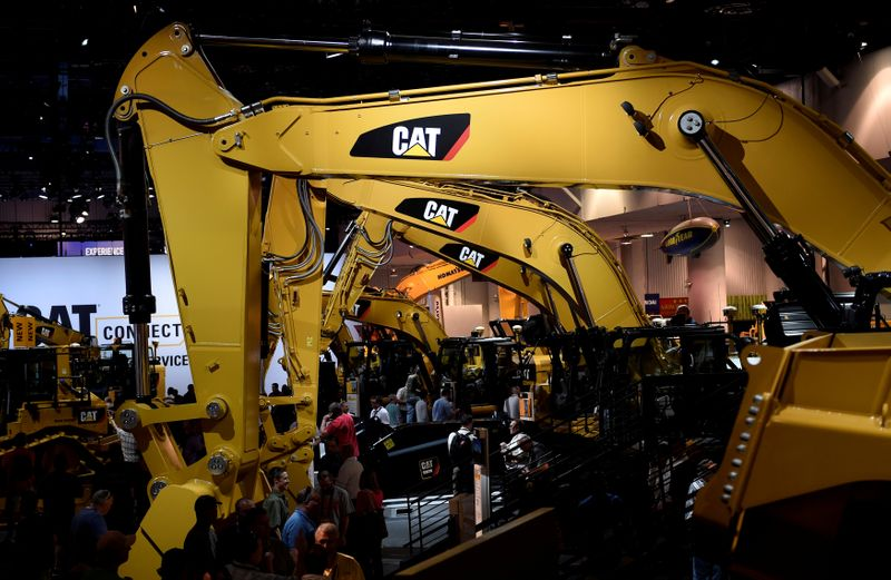 FILE PHOTO: A row of excavators are seen at the Caterpillar booth at the CONEXPO-CON/AGG convention at the Las Vegas Convention Center in Las Vegas