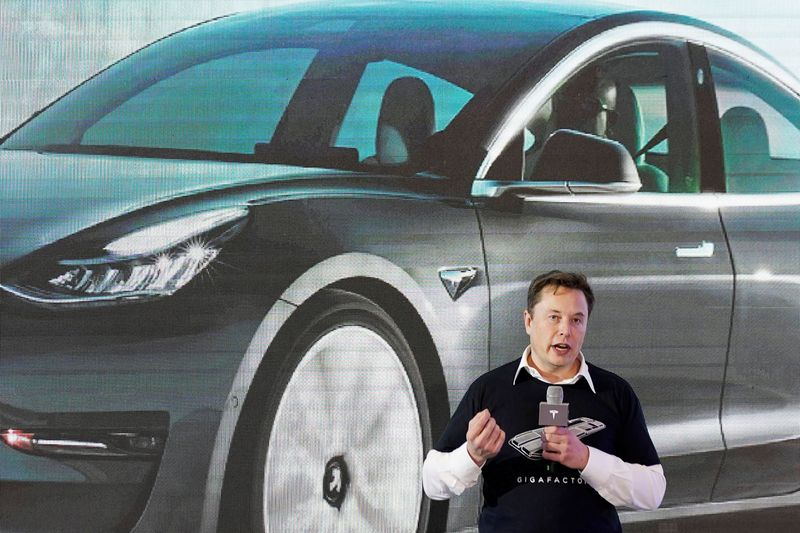 FILE PHOTO: Tesla Inc CEO Elon Musk speaks at a delivery event at the company's factory in Shanghai
