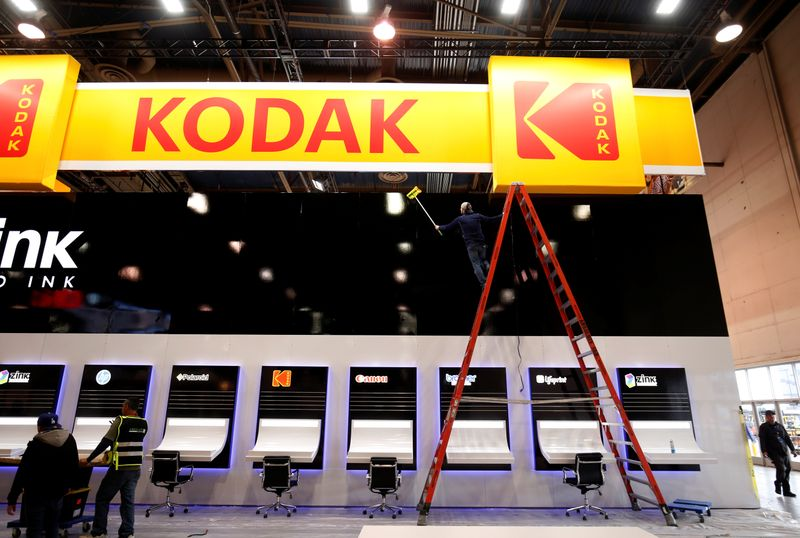FILE PHOTO: A worker cleans a Kodak booth at the Las Vegas Convention Center in preparation for 2019 CES in Las Vegas