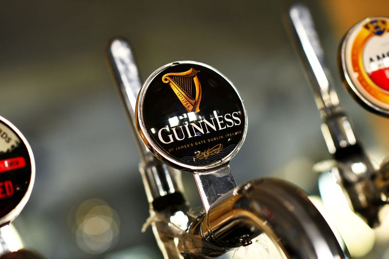 FILE PHOTO: A Guinness beer tap is seen inside The Greenwich Pensioner pub in London