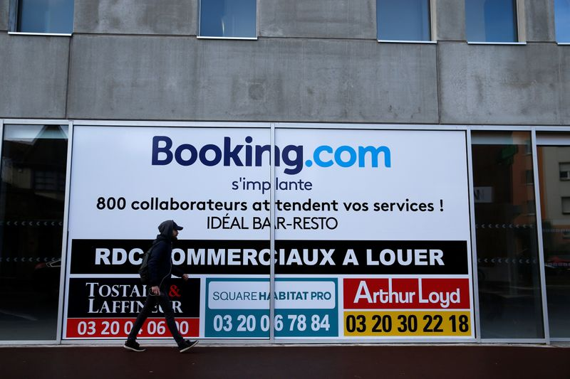 A man walks past the new Booking.com customers site in Tourcoing