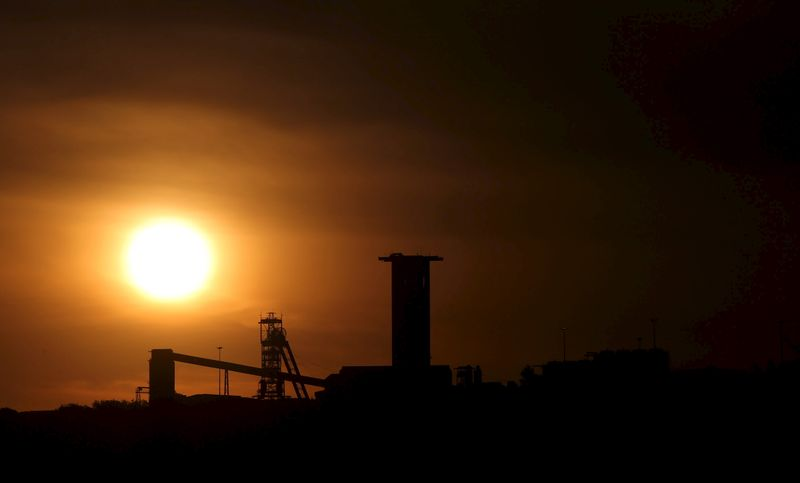 Sun sets behind a shaft outside the mining town of Carletonville