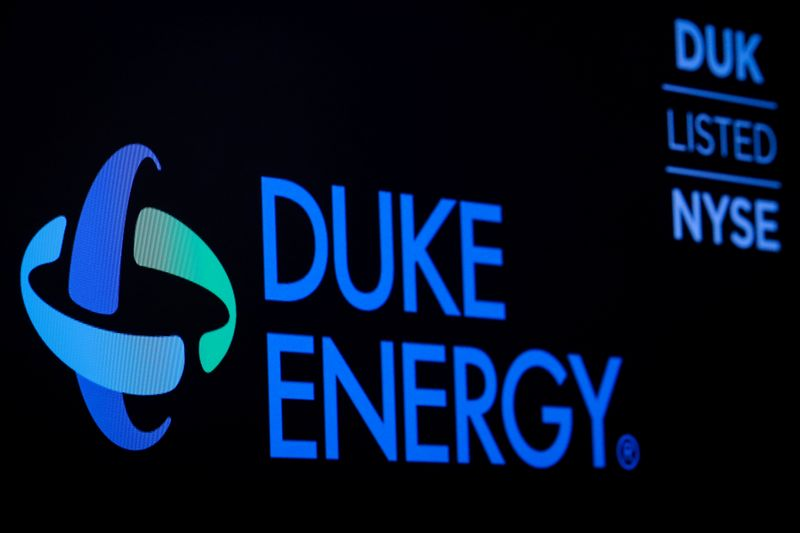 The company logo and ticker for Duke Energy Corp. is displayed on a screen on the floor of the NYSE in New York