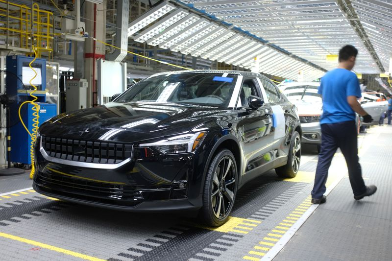 FILE PHOTO: Workers are seen on a production line for Polestar, Volvo and Lynk&Co vehicles at a Geely plant in Taizhou