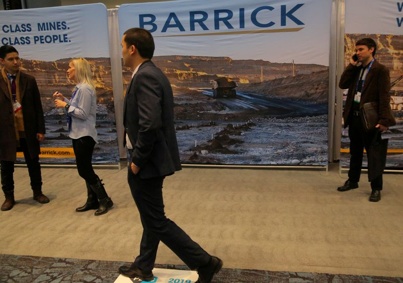 A visitor passes a Barrick Gold mining company display during the PDAC convention in Toronto