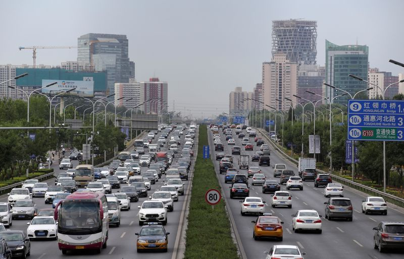 FILE PHOTO: Cars are pictured during the morning rush hour in Beijing