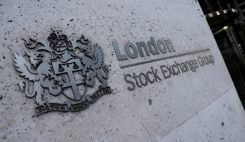 FILE PHOTO: Signage is seen outside the entrance of the London Stock Exchange in London