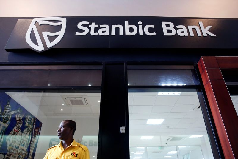 Security guard stands at the entrance of the Stanbic Bank in Abidjan