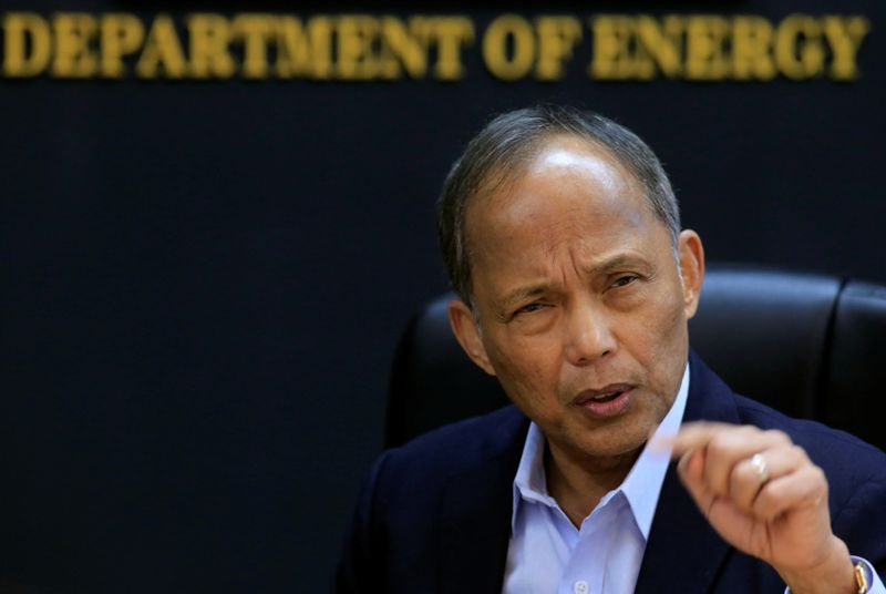 FILE PHOTO: Philippine Department of Energy (DOE) Secretary Alfonso Cusi gestures during a Reuters interview at the DOE headquarters in Taguig city, Metro Manila