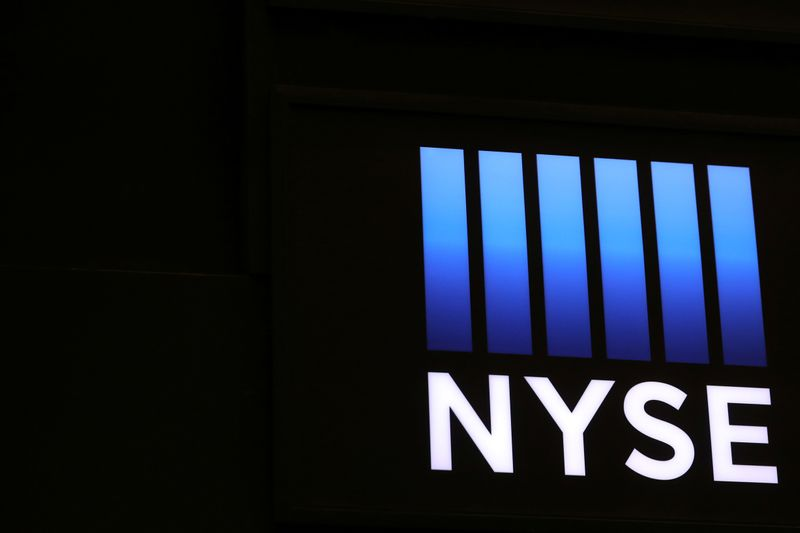 The logo for the NYSE is displayed on the trading floor in New York