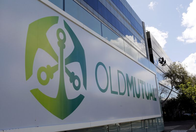 FILE PHOTO: Workers clean windows outside the Cape Town headquarters of Anglo-South African financial services company Old Mutual