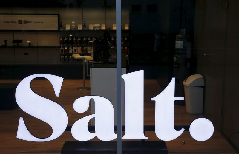 The new logo of Swiss mobile telecommunications operator Salt. is pictured in a shop in the company headquarters in Renens