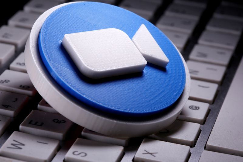FILE PHOTO: A 3D printed Zoom logo is placed on the keyboard in this illustration taken