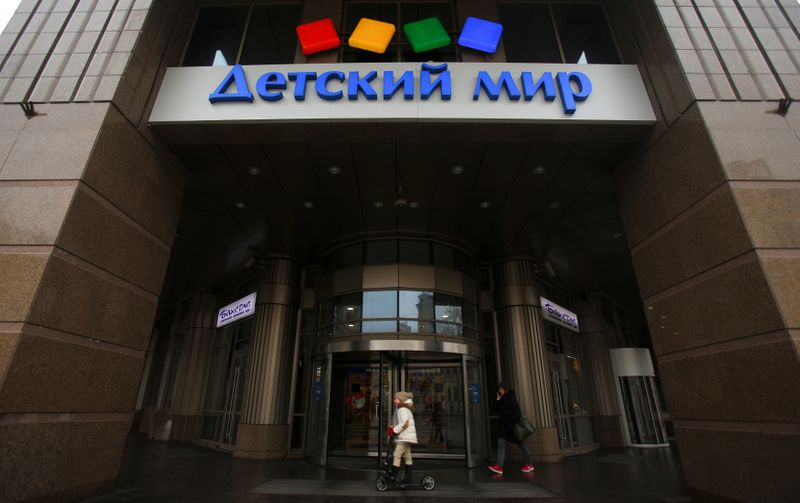 FILE PHOTO: A board, showing the logo of Russian children's goods retailer Detsky Mir, is on display in Moscow