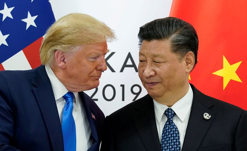 FILE PHOTO: Trump meets Xi at the G20 leaders summit in Osaka, Japan