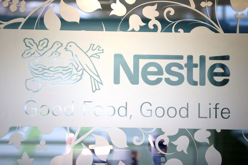 Nestle logo is pictured on the door of the supermarket of Nestle headquarters in Vevey