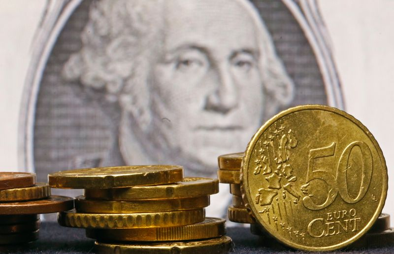 FILE PHOTO: Euro coins are seen in front of a U.S. one dollar banknote displayed in this picture illustration taken in Zenica.
