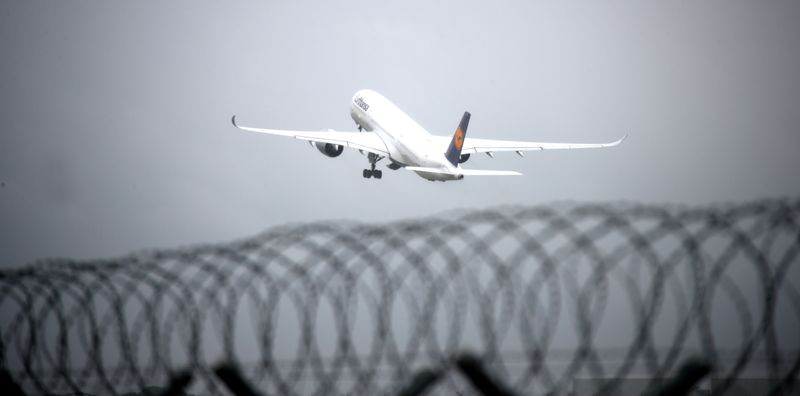 FILE PHOTO: An Airplane of German carrier Lufthansa takes off from Munich International Airport