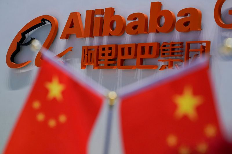 FILE PHOTO: FILE PHOTO: A logo of Alibaba Group is seen at the company's headquarters in Hangzhou