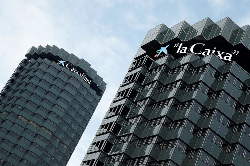 CaixaBank's logo is seen on top of the company's headquarters in Barcelona