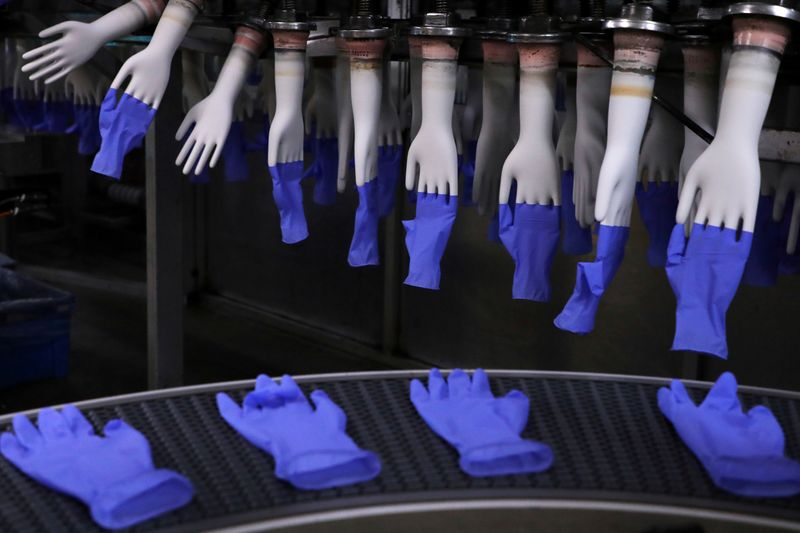 FILE PHOTO: Newly-made gloves are pictured inside Top Glove factory in Shah Alam