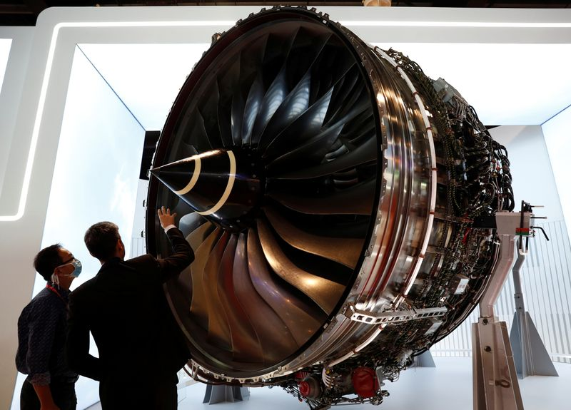 FILE PHOTO: A man looks at Rolls Royce's Trent Engine displayed at the Singapore Airshow in Singapore