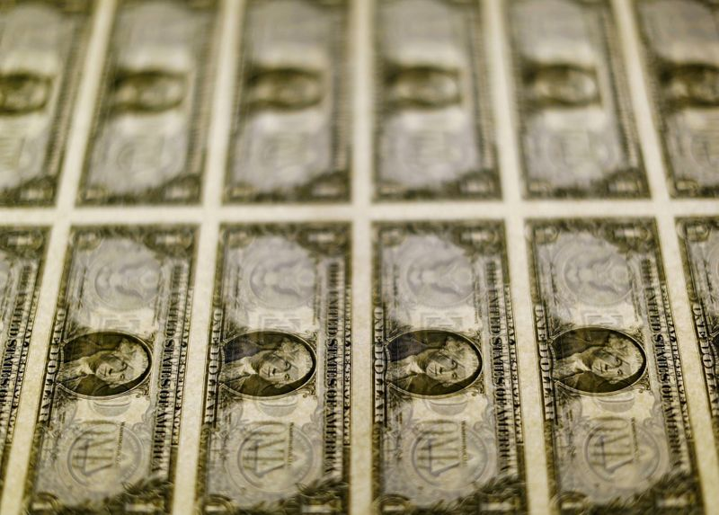 U.S. dollar bills are seen on a light table at the Bureau of Engraving and Printing in Washington