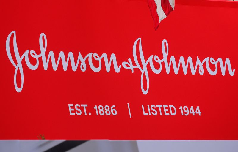 FILE PHOTO: The company logo for Johnson & Johnson is displayed to celebrate the 75th anniversary of the company's listing at the NYSE in New York