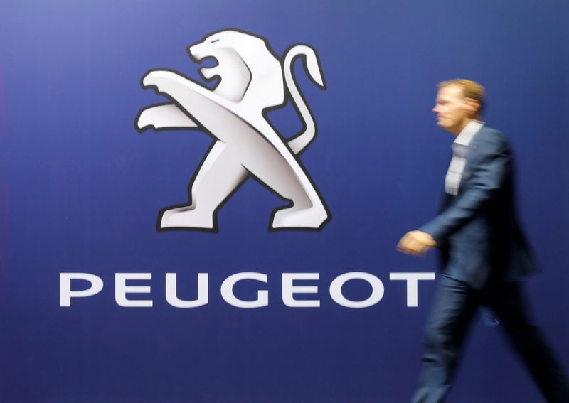 FILE PHOTO: Logo of French car manufacturer Peugeot is seen at the 33th Auto Zurich Car Show in Zurich