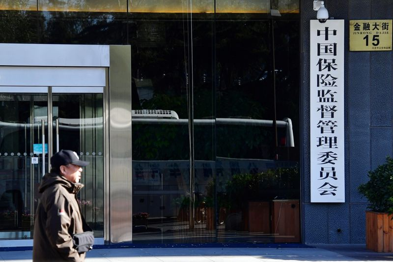 FILE PHOTO: A man walks past an office building of CIRC in Beijing