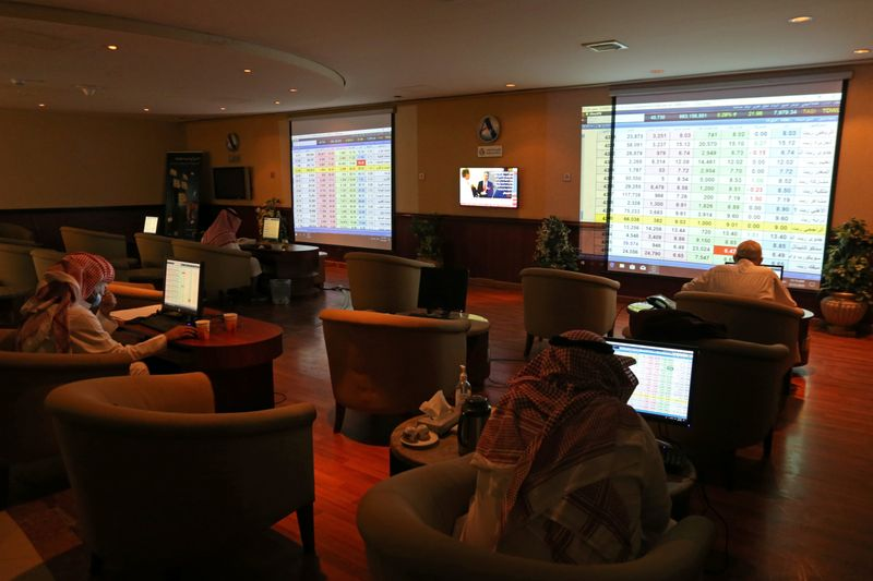 Saudi traders monitor stock information at the Saudi stock market in Riyadh