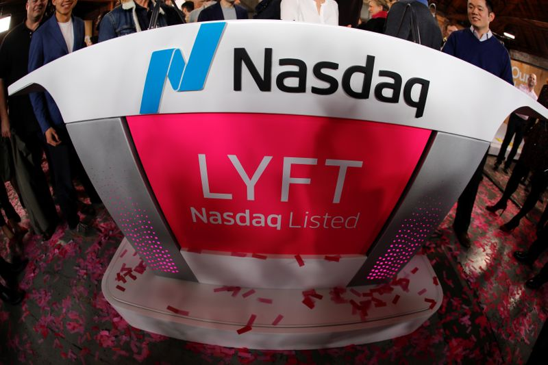 The Lyft logo is shown following the Lyft listing on the Nasdaq at an IPO event in Los Angeles,