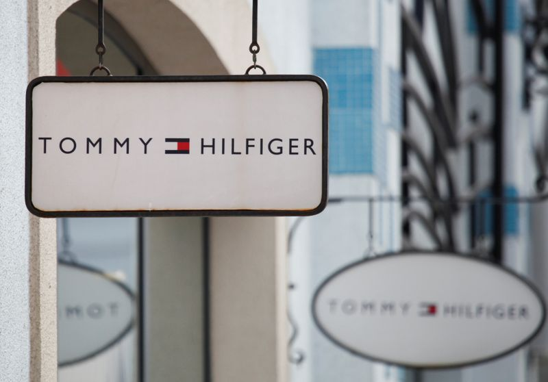 Boards with Tommy Hilfiger store logo are seen on a shopping center at the outlet village Belaya Dacha outside Moscow