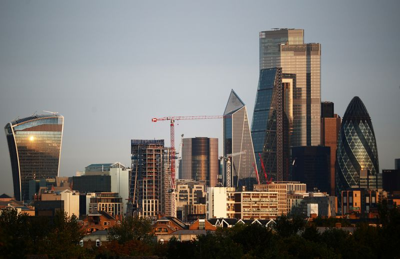 FILE PHOTO: Skyscrapers in The City of London financial district are seen during sunrise in London