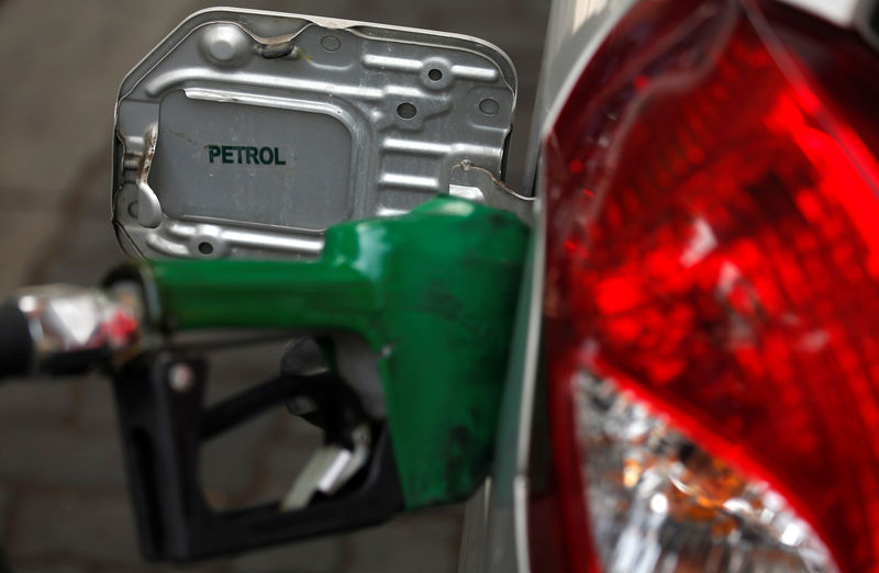 A nozzle pumps petrol into a vehicle at a fuel station in Mumbai