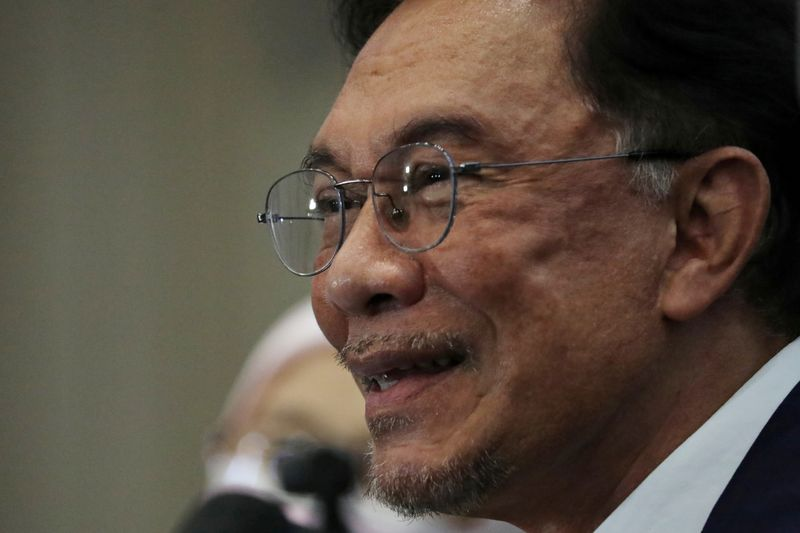 FILE PHOTO: Malaysia opposition leader Anwar Ibrahim reacts during a news conference in Kuala Lumpur