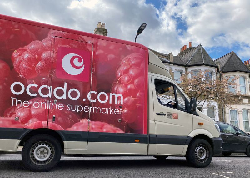 FILE PHOTO: An Ocado delivery van is driven along a road in Hackney, London, Britain
