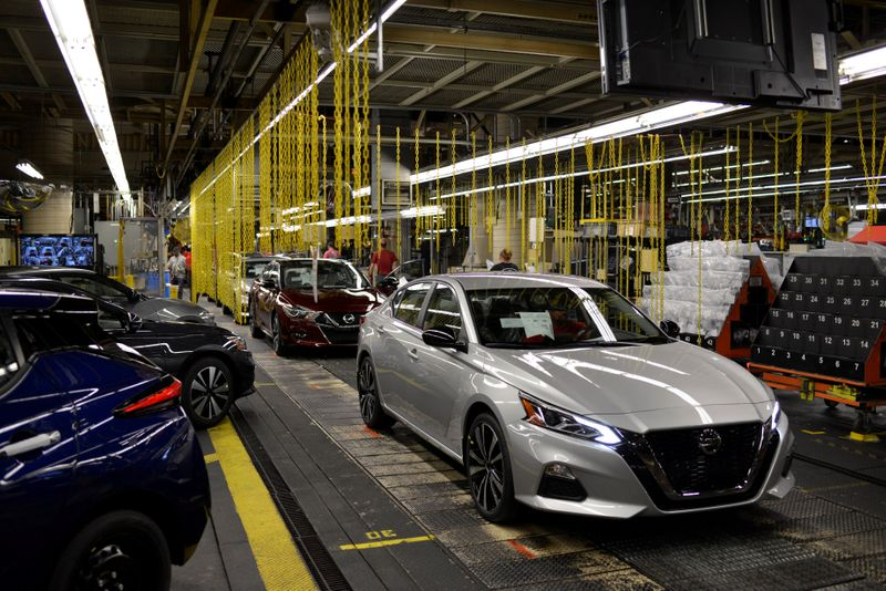 FILE PHOTO: A finished Nissan Maxima followed by a Nissan Altima comes off the line at Nissan Motor Co's automobile manufacturing plant in Smyrna Tennessee