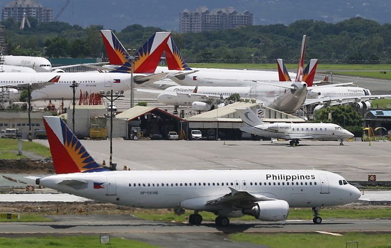FILE PHOTO: A Philippine Airlines (PAL) aircraft taxis on a runway at Manila International Airport