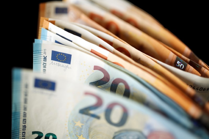 50 and 20 Euro banknotes are displayed in this picture illustration